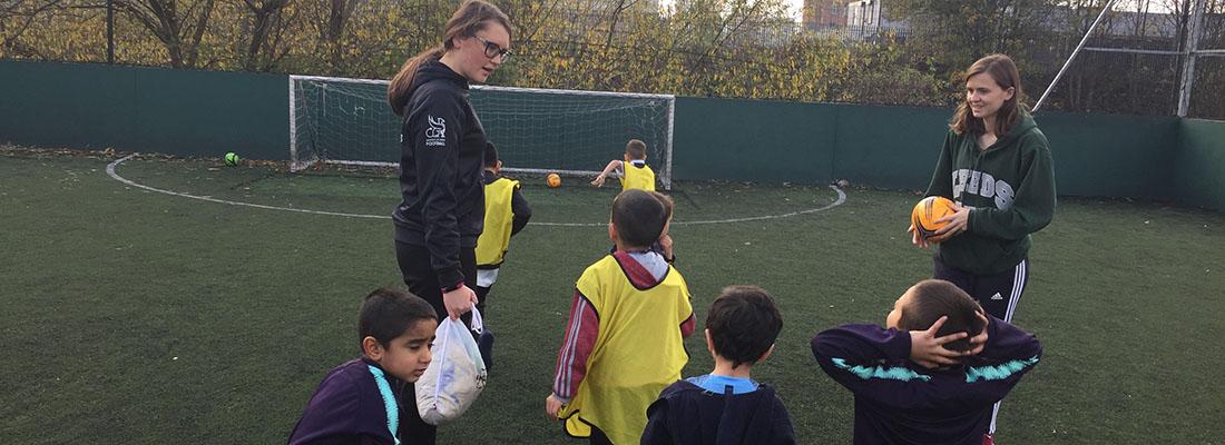 Students volunteering as a Hyde Park Football Club coach